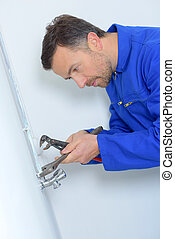 Plumber using tools to together joint