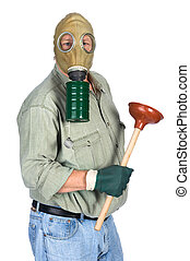 Plumber wearing gas mask - A plumber wears his gas mask as...