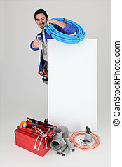 Plumber with a cellphone a board left blank for your image