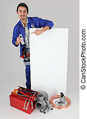 Plumber with a phone and a board left blank for your message