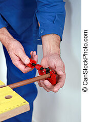 Plumber with a pipe cutter