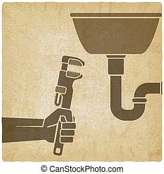 plumber with wrench repairing leaking pipe vintage background