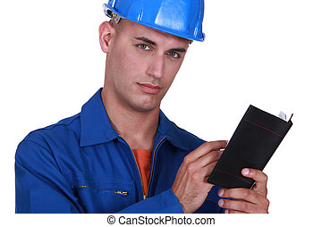 Plumber writing in appointment book