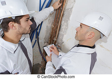 plumbers checking cooper pipes