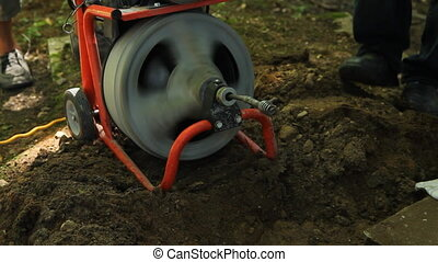 Plumbers snake. - A plumbers snake is an electric auger used...