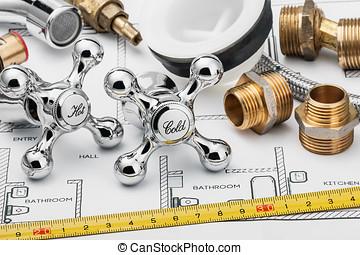plumbing and tools lying on drawing