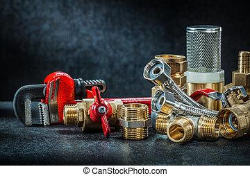 plumbing brass pipe connectors on dark background