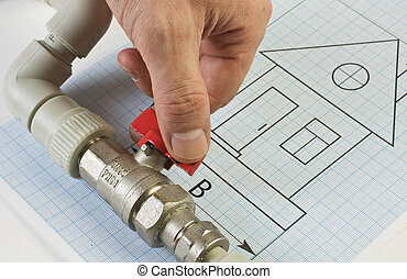 plumbing fittings in hand on drawing