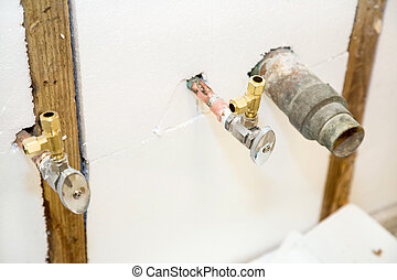 Plumbing Fixtures in Insulated Wall - Closeup view of...