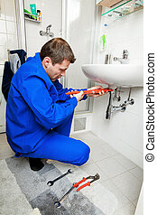 A plumbing repair a broken sink in bathroom