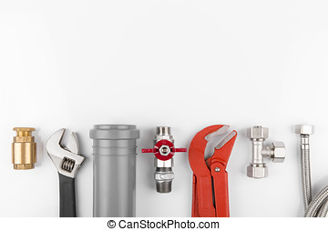 plumbing tools and equipment on white with copy space