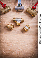 Plumbing Tools Brass Pipe Connectors On Wooden Board