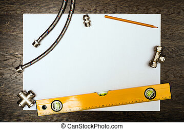 plumbing tools on a white sheet of paper