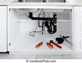 Plumbing tools in the kitchen. Plumber service.