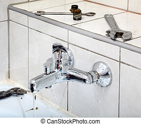 Plumbing - Water leaking from tap in a bathroom and plumber...