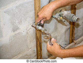 Plumbing with Copyspace - Plumbers hands using a wrench and...