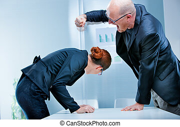 plump businessman hitting a skinny businesswoman - plump...