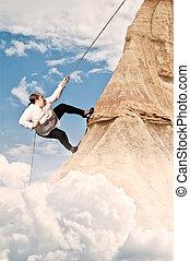 woman climbing on mountain