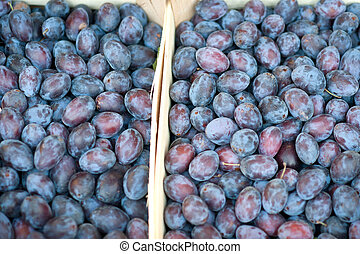 Plums at a market