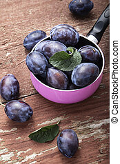 plums on the table on a shabby background