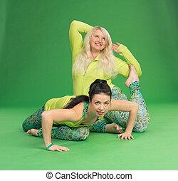 Plus size and slim girls making yoga poses