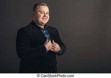 businessman in black suit on black background