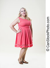 Plus size fashion model, fat woman on beige background, overweight female body