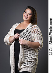 Plus size fashion model in casual clothes, fat woman on gray...