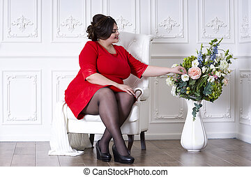 Plus size fashion model in red evening dress, fat woman on...