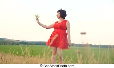 Plus size fashion model in slow motion video walking on the...