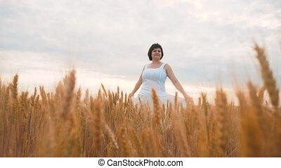 Plus size fashion model in slow motion video walking white...