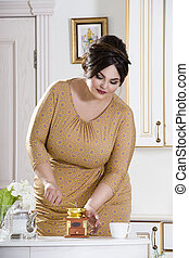 Plus size fashion model on kitchen, fat woman on luxury interior, overweight female body