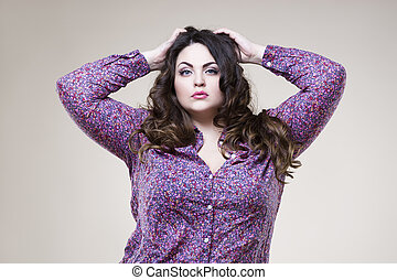 Plus size fashion model, sexy fat woman on beige background
