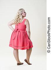 Plus size fashion model, sexy fat woman on beige background