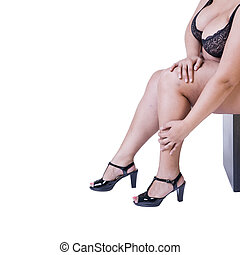 Plus size model in black high heels shoes, xxl woman isolated on white background, legs fatigue