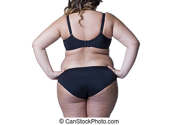 Plus size model in black lingerie, overweight female body, fat woman with cellulitis on buttocks isolated on white background
