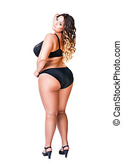 Plus size sexy model in black underwear, fat woman isolated on white background, overweight female body
