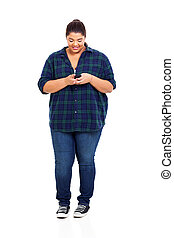 plus size teenager reading email on smart phone