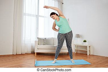 plus size woman exercising on mat at home - fitness, sport, ...
