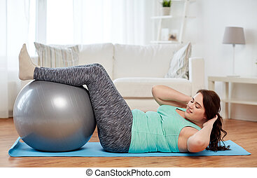 plus size woman exercising with fitness ball - sport, people...