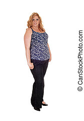 Plus size woman standing in jeans.