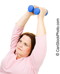 Plus Size Woman Using Hand Weights - Pretty, plus size woman...