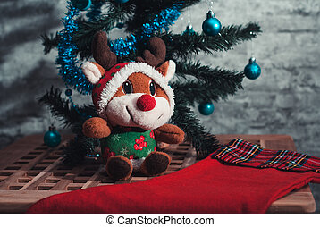 Plush stuffed toy, funny deer under the tree,