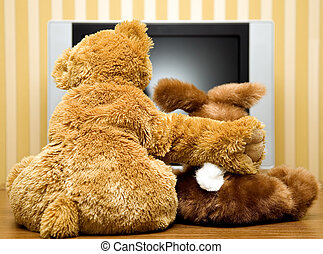 Plushy toys near lcd televisor - Plushy toys are sitting...