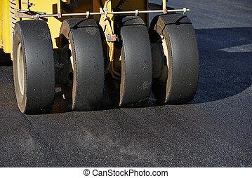 pneumatic asphalt roller at work
