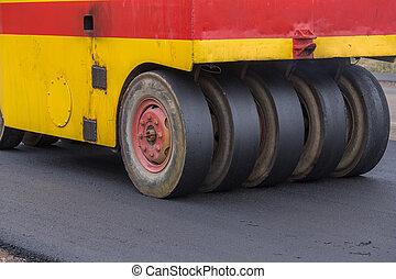 Pneumatic tyred roller compactor at asphalt road