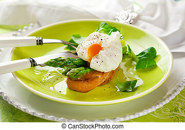 Poached egg and green asparagus on toast