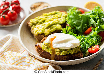 Poached egg on rye toast with avocado