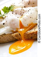 Poached Eggs on Toast - Poached eggs on toast, garnished...