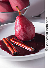 Poached pear in red wine with spices
